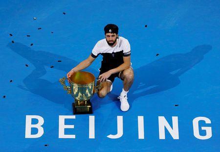 Nikoloz Basilashvili poses with his trophy after defeating Juan Martin del Potro. Photo: Thomas Peter/Reuters