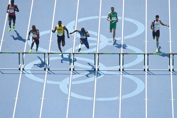 Mucheru, second from left, almost caught Clement near the end | Photo: AFP.