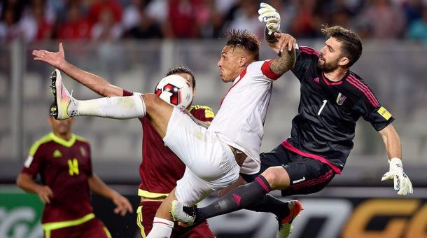 Peru's Paolo Guerrero (Center) fighting for the ball in Fridays World Cup Qualifier match against Venezuela in Lima. Photo provided by AFP.