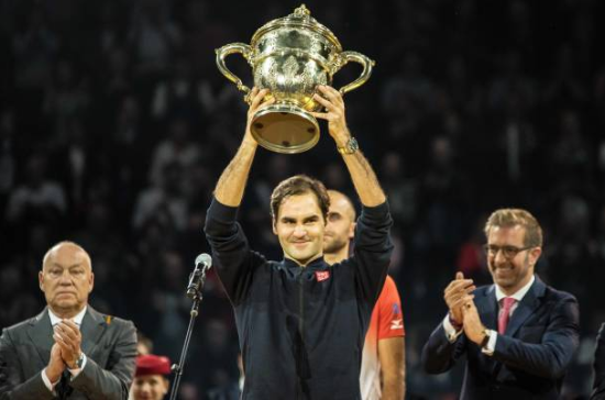 Roger Federer hoists another trophy in his hometown of Basel. Photo: TF Images/Getty Images