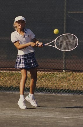 "In contrast to the many wealthy kids who trained at the Nick Bollettieri Tennis Academy, Sharapova said she appeared at the academy ""with a single change of clothes, an oversized chopped-down racket, and shoes from a factory in Minsk."" 