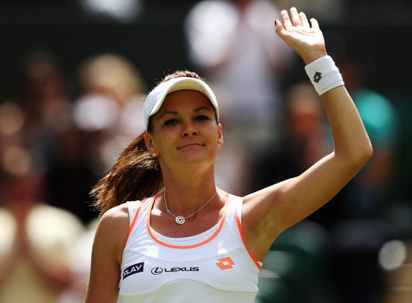 Radwanska acknowledges the crowd after her second round win at the 2014 Wimbledon Championships. Photo credit: Steve Bardens/Getty Images.