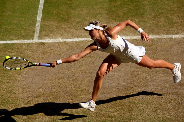 Eugenie Bouchard in action at Wimbledon 2014 (Photo by Clive Brunskill/Getty Images)
