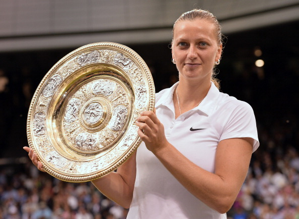 Kvitova graces with the Venus Rosewater Dish after winning the Wimbledon Championships in 2014, her second and most recent Grand Slam crown. Photo credit: Karwai Tang/Getty Images,