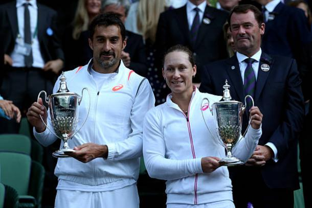 Sam Stosur with Horia Tecau after the two won the Mixed Doubles title at Wimbledon in 2014 (Getty/Matthew Stockman)