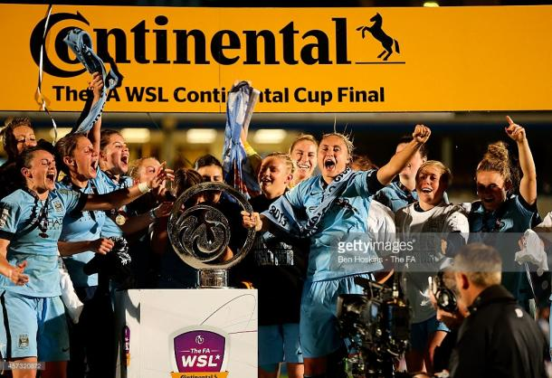 City celebrate winneing their first silverware in 2014