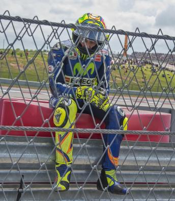 Rossi looks dejected after crashing out. (Photo: