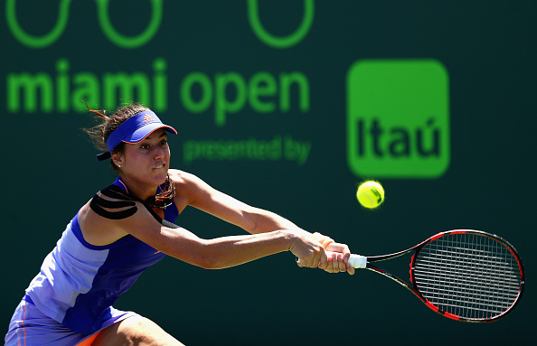 Sorana Cirstea of Romania plays a backhand to Christina McHale of the United States in their first round match during the Miami Open at Crandon Park Tennis Center on March 25, 2015 in Key Biscayne, Florida. (Photo by Clive Brunskill/Getty Images)
