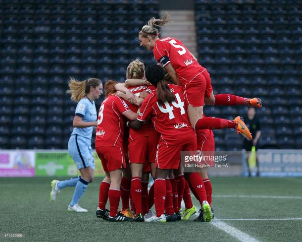 April 2015, the last time City were beaten in the league. Liverpool players celebrate Line Smorsgard's winner