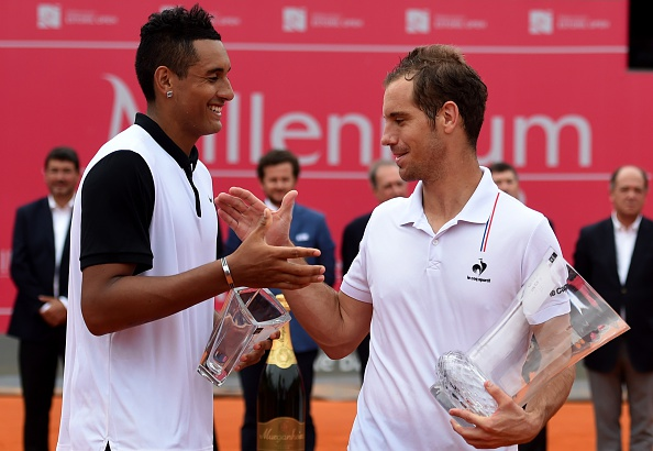 French tennis player Richard Gasquet (R) shakes hands with Australian tennis player Nick Kyrgios on the podium of the final of the Estoril Open Tennis tournament, in Estoril on May 3, 2015. Gasquet won 6-3, 6-3 and 6-2. AFP PHOTO/ FRANCISCO LEONG (Photo credit should read FRANCISCO LEONG/AFP/Getty Images)