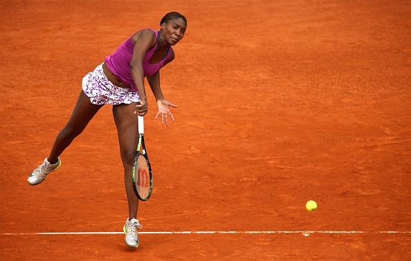 Venus Williams serves at the 2015 Mutua Madrid Open/Getty Images