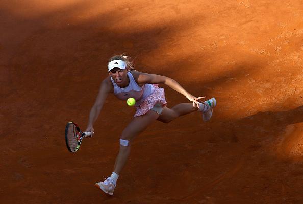 Caroline Wozniacki runs down a forehand at the Internazionali BNL D'Italia in Rome/Getty Images