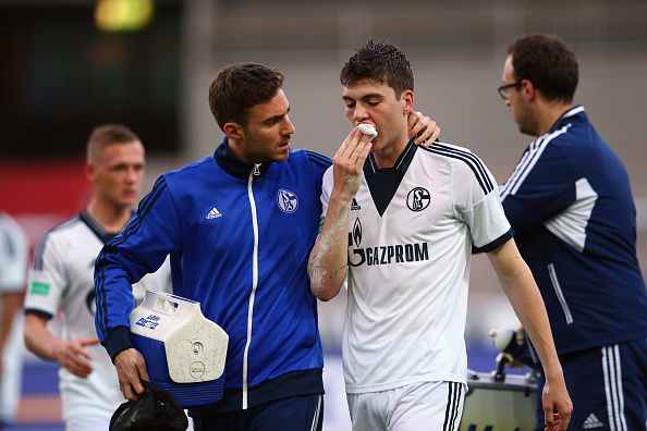 Jacob Rasmussen of Schalke receives treatment during the A Juniors Bundesliga Semi Final match between U19 Karlsruher SC and U19 FC Schalke 04 at Wildparkstadion on May 13, 2015 in Karlsruhe, Germany. (Photo by Alex Grimm/Bongarts/Getty Images)