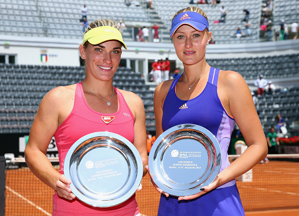Mladenovic (right) with her partner Babos claiming their third title together in Rome beating Santina | Photo: Ian Walton/Getty Images