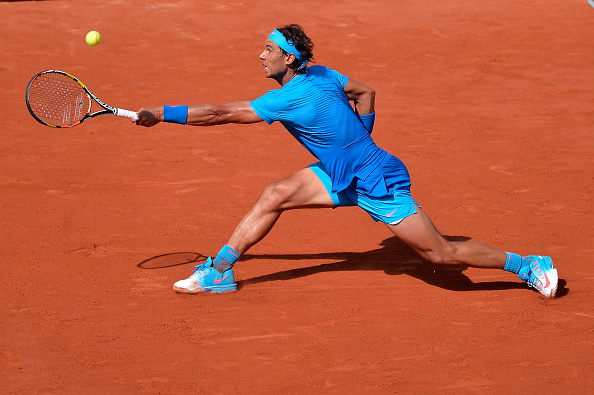 Rafael Nadal slides into a backhand at the 2015 French Open in Paris/Getty Images