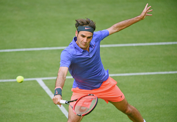 Roger Federer hits a volley at the 2015 Gerry Weber Open in Halle/Getty Images