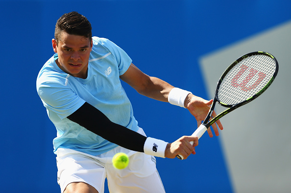 Milos Raonic lays a backhand shot (Photo: Clive Brunskill/Getty Images)