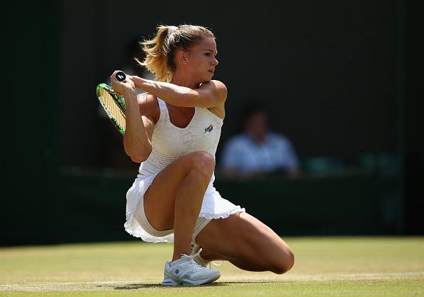 Camila Giorgi returns a shot in her match against Caroline Wozniacki at the Wimbledon Lawn Tennis Championships. (Photo by Ian Walton/Getty Images)