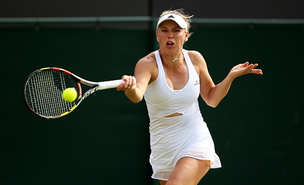 Caroline Wozniacki hits a forehand at Wimbledon/Getty Images