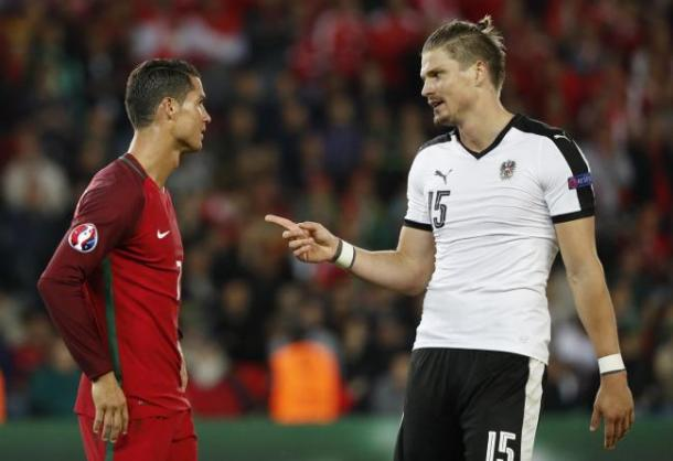 The defender talking to Cristiano Ronaldo at Euro 2016 (Photo: Getty Images)