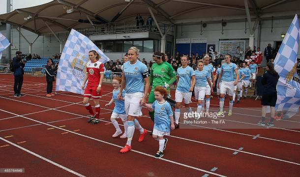 Houghton leads MCWFC out for their first ever WSL home game