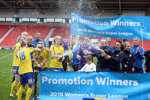 Doncaster players celebrate their promotion back to WSL1 (Photo credit: Nigel Roddis/Getty)