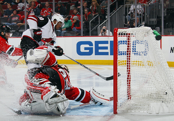 Anthony Duclair #10 of the Arizona Coyotes scores at powerplay goal at 47 seconds of the third period against Cory Schneider #35 of the New Jersey Devils at the Prudential Center on October 20, 2015 in Newark, New Jersey. The Devils defeated the Coyotes 3-2 in overtime. (Photo by Bruce Bennett/Getty Images)