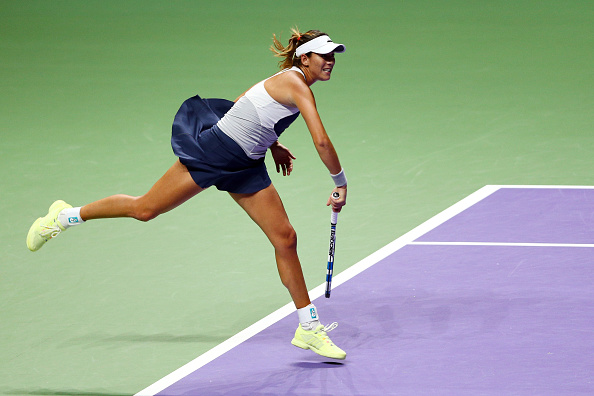 Garbiñe Muguruza serves at the 2015 WTA Finals. Photo: Getty Images