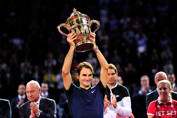 Roger Federer lifts his seventh Swiss Indoors trophy/Getty Images