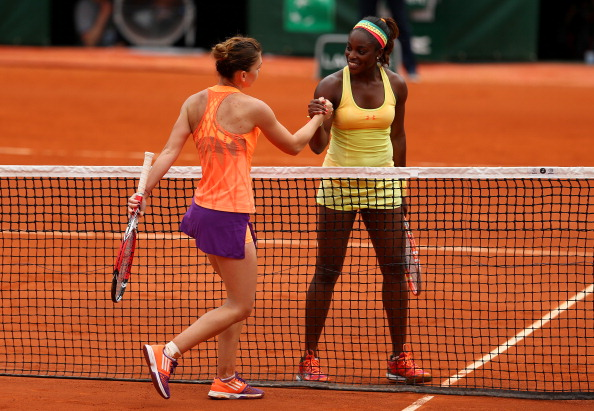 Stephens and Halep embrace each other at the net after their round of 16 match at the 2014 French Open. Photo credit : Clive Brunskill