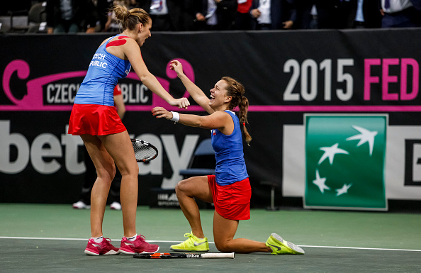 Strycova (right) and Pliskova celebrate after converting a match point to give Czech Republic the Fed Cup title last year. Photo credit: Matej Divizna/Getty Images.