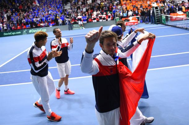 The French team celebrates their win over the Netherlands. Photo: Corinne Dubreuil/Davis Cup