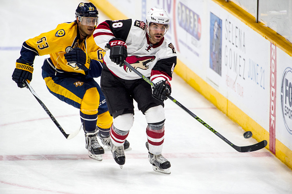 Jordan Martinook #48 of the Arizona Coyotes skates with the puck against Mike Ribeiro #63 of the Nashville Predators during a NHL game at Bridgestone Arena on December 1, 2015 in Nashville, Tennessee. (Photo by Ronald C. Modra/NHL/Getty Images)