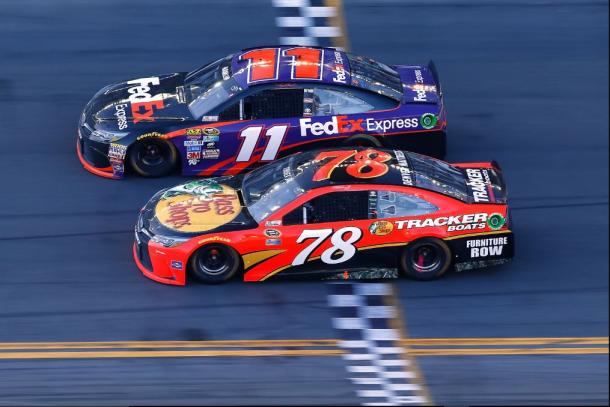 Denny Hamlin takes the checkered flag in a photo finish last year. (Jonathan Ferrey/Getty Images)