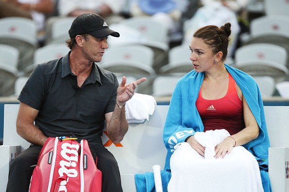 Cahill offers Halep advice during a changeover at the Apia International Sydney in January. Photo credit: Matt King/Getty Images.