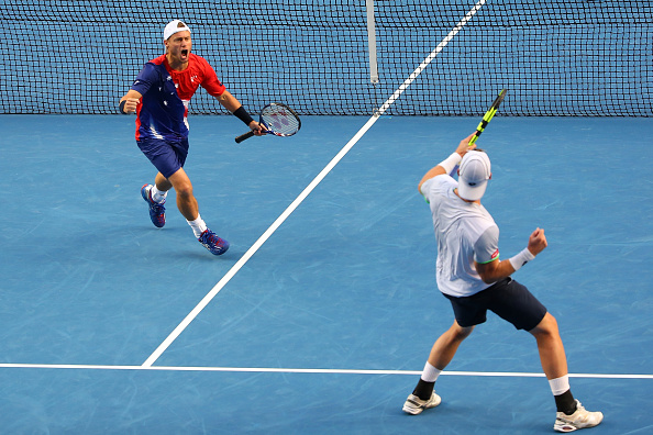 Lleyton Hewitt (left) and Sam Groth celebrate during their second round upset (Photo: Getty Images)