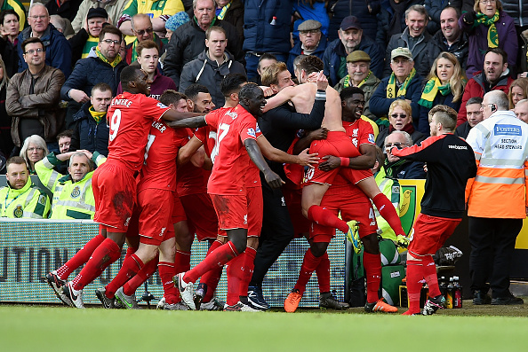 Adam Lallana and the rest of the team celebrate his winner against Norwich City in a 4-5 win for the Reds (Photo by John Powell/Liverpool FC via Getty Images)