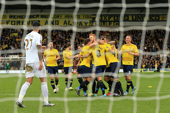 Kyle Bartley watches as Oxford United celebrate in their 3-2 win over Swansea. That has been the defender's only first team action of 2016. (Marc Atkins/Mark Leech Sports Photography/Getty Images)