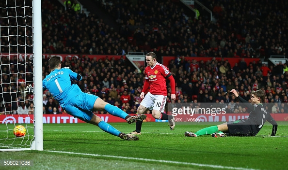 Rooney scoring United's third against Stoke at Old Trafford last season | Photo: Alex Livesey / Getty Images