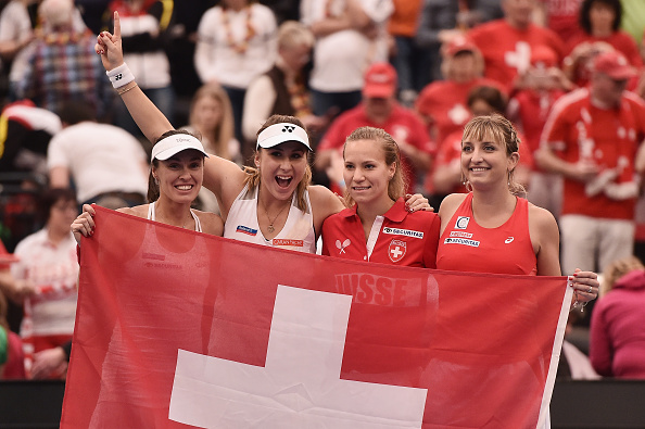 Golubic (second from right) and her teammates acknowledge their Swiss supporters after defeating hosts Germany in the opening round. Photo credit: Dennis Grombkowski/Getty Images.