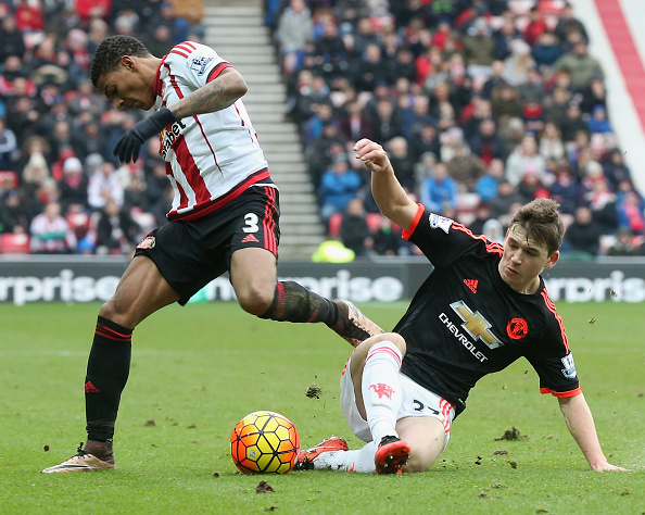 Donald Love tackling Patrick Van Aanholt on his Manchester United debut in their 2-1 defeat to Loce's new club Sunderland | Photo: Getty Images
