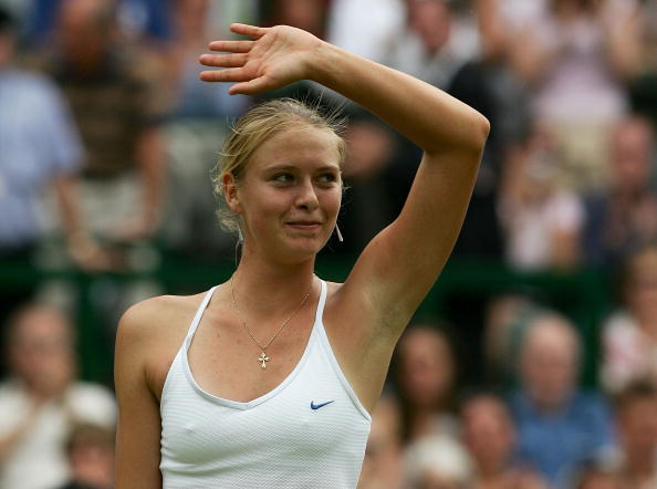 Maria Sharapova celebrates winning her quarter final match against Ai Sugiyama in Wimbledon 2004. (Photo by Mike Hewittl/Getty Images)