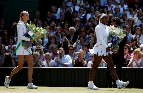 Maria Sharapova (L) and Serena Williams arrive on court moments before the ladies final match at the Wimbledon Lawn Tennis Championship on July 3, 2004. (Photo by Mike Hewitt/Getty Images)