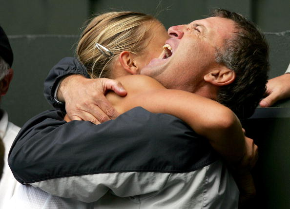 Maria Sharapova hugs her father Yuri as she celebrating winning the ladies final match against Serena Williams at the Wimbledon Lawn Tennis Championship on July 3, 2004. (Photo by Clive Brunskill/Getty Images)