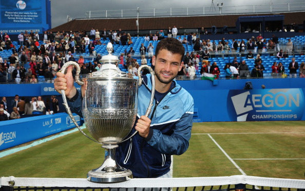 Grigor Dimitrov with the Queens Club trophy in 2014 following a win against Feliciano Lopez (Photo: Matthew Stockman/Getty Images)