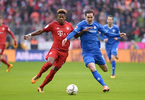 Sandro Sirigu (right) battles with Bayern Munich's David Alaba. (Photo: Lukas Barth/Anadolu Agency/Getty Images)