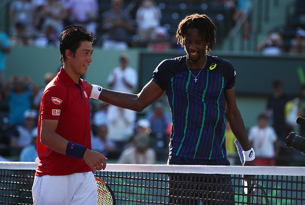 Kei Nishikori shakes hands at the net after his three set victory against Gael Monfils in their quarter final match during the Miami Open (Photo:Clive Brunskill/Getty Images)