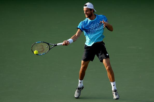 Joao Sousa returns a shot to Novak Djokovic during the Miami Open (Photo:Matthew Stockman/Getty Images)