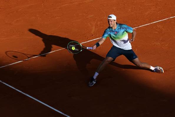 Lucas Pouille returns a forehand to Richard Gasquet in his second round win (Photo: Jean-Christophe