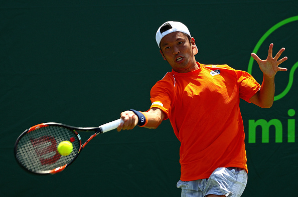 Tatsuma Ito returns a shot to Gael Monfils in his match at the Miami Open (Photo:Mike Ehrmann/Getty Images)